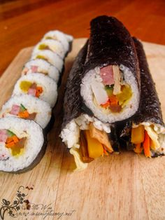 "Kimbap - Korean ""Sushi"" Rolls with pickled radish, carrot, egg, etc."