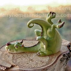 Fairy Homes and Gardens - Miniature Green Dragon Playing with Ladybug, $8.98 (https://www.fairyhomesandgardens.com/miniature-green-dragon-playing-with-ladybug/)