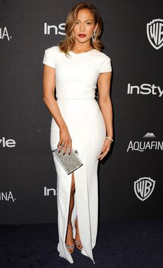 Jennifer Lopez in white Roland Mouret number with origami cap sleeves and a front slit.