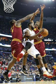 Tyreke Evans #1 of the New Orleans Pelicans passes the ball around Dion Waiters #3 of the Cleveland Cavaliers at Smoothie King Center on December 12, 2014 in New Orleans, Louisiana.