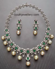 18 carat white gold floral necklace studded with diamonds, emeralds and south sea pearls - Mangatrai Jewelers