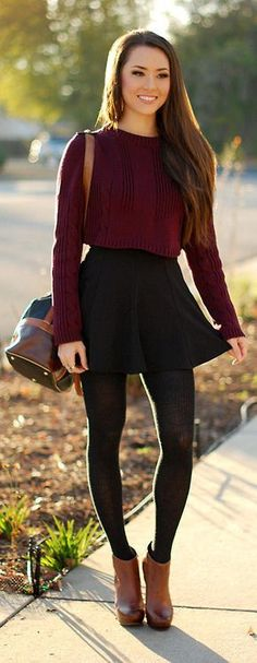 crop sweater, mini black skirt, tights, and brown boot