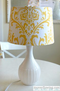 Budget Friendly Family Room • Easy tutorial for covering a lampshade with fabric!