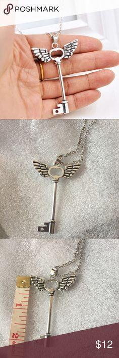 "Angel Key Necklace Pretty silver toned skeleton key with heart and wings necklace. Silver toned mixed alloy. Chain is 18"" plus a 2"" extender. New in package. Jewelry Necklaces"