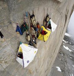 Cliff face camping.  Why, why, why do people insist on going places where birds should only be?  No way I could sleep.  I would be thinking about the equipment failing!