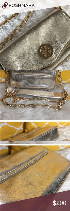 """Authentic Tory Burch cute crossbody. Adorable crossbody tiny spots on back not noticeable. Diminsions 7.5 x 4"""" bottom 1.5"""" gold leather and logo .Gold chain . Removable strap. Can be clutch or shoulder or crossbody. Tory Burch Bags Crossbody Bags"""
