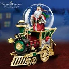 """This train engine Santa Claus snowglobe is a great twist on an old-fashioned Christmas train display. Snow swirls around Santa as the engine features art by Thomas Kinkade and plays the tune """"We . Christmas Snow Globes, Christmas Train, Diy Christmas Gifts, Christmas Decorations, Christmas Ornaments, Merry Christmas, Holiday Gifts, Thomas Kinkade Art, I Love Snow"""