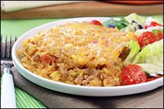 Taco-rific Spaghetti Squash Bake  Ingredients:   1 spaghetti squash (about 4.5 lbs.)  3/4 cup chopped bell pepper  1/2 cup chopped onion  12 oz. raw lean ground turkey  4 1/2 tsp. taco seasoning mix  1/2 cup frozen sweet corn kernels, thawed  1 cup shredded reduced-fat Mexican-blend cheese  1 cup chunky salsa  1/4 cup fat-free sour cream