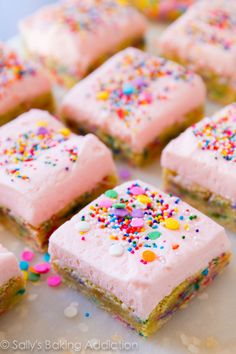 Frosted Sugar Cookie Bars - soft baked and heavy on the sprinkles! Recipe by sallysbakingaddiction.com