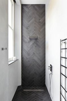 Love the dark grey Herribone Pattern concrete tiles. Such a dramatic effect. Bathroom by Dyer Grimes Architecture.