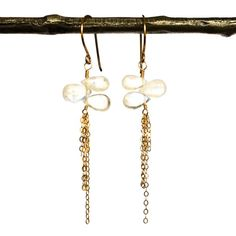 Delicate+threads+of+chain+fall+from+smooth+rainbow+moonstone+trios.+14kt+gold-filled.+Length:+approximately+2.75