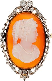 Hardstone Cameo, Diamond, Platinum-Topped Gold Brooch, circa 1900 The pendant-brooch features a carved sardonyx cameo measuring 31.00 x 21.00 mm, enhanced by European-cut diamonds weighing a total of approximately 0.50 carat, enhanced by rose and mine-cut diamonds, set in platinum-topped 18k gold. Gross weight 14.85 grams.