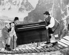 Comedians Oliver Hardy and Stan Laurel carry a piano across a rope bridge in a scene from 'Swiss Miss' directed by John G Blystone 1938 An escaped. Laurel And Hardy, Stan Laurel Oliver Hardy, Moving A Piano, What's So Funny, Funny Guys, Funny Men, Stupid Funny, Swiss Miss, Comedy Duos