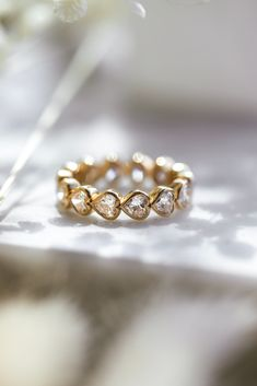The abundant heart diamond bezel eternity ring exuberates love and compassion. If you love a heart shaped diamond, this is the ring for you. Depending on the finger size, the number of stones may vary, but no matter the finger size the eternity ring is continually shining with joy.