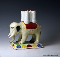 Staffordshire pottery figure of a an elephant carrying a castle form incense burner, Engliah circa 1810