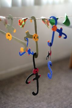 Hang a line across the area and have items with hooks to hang from the line as well as each other.  Fun