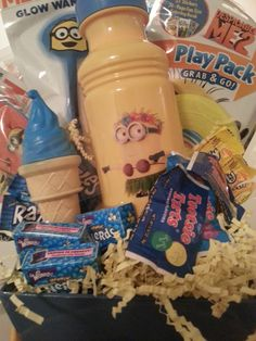 We love Minions at Dylan's. Enjoy this Gift Basket from the Despicable Me franchise. Included n this Gift Basket is Minions Water Bottle, Despicable Me 2 Giant Bubble Wand, Despicable Me 2 Glow Wand, Minions Paddle Ball, Despicable Me Play Pack Grab & Go, Big Fun Book of Color, Mini Frisbee, Ice Cream Scented Bubbles, 3- Blueberry Nerds Candy, 3-Tootsie Tarts, 3-Razzles Gum, 3-Banana Laffy Taffy Candy all packaged in a Minions Carrying Basket #4240  $32