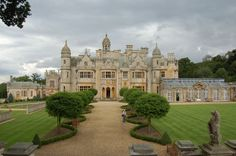 """castlesandmanorhouses:  Harlaxton Manor, built in 1837, is a manor house in Harlaxton, Lincolnshire, England. Its architecture combines elements of Jacobean and Elizabethan styles with symmetrical Baroque massing, making it unique among surviving """"Jacobethan"""" manors. The manor is a popular location for filming. Exterior and interior shots have been featured in the films The Ruling Class, The Last Days of Patton, The Lady and the Highwayman, The Haunting and The Young Visiters."""