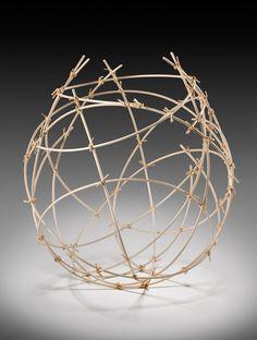 """Jennifer Liston Dykema - Fiber - Linear Basket. Natural reed with raffia. 19""""h x 16""""w x 16""""d."""