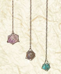"""Introduce more positive energies into your life with this 29"""" Caged Stone Necklace. The beautiful stone hangs from a silvertone twist chain and is covered by a"""