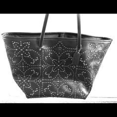 Black Coach Tote bag Spotless and beautiful; never been used, tags still attached! Make me an offer! Coach Bags Totes