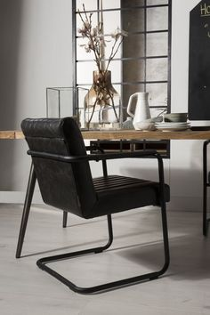 Stitched armchair van Dutchbone #industrieel #leer #zwart #staal #dutchbone #dewoonzaken #stoer