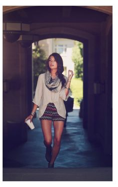 Aflowy high low shirt half tucked into printed shorts looks super cute.  Add a scarf for a fall vibe!