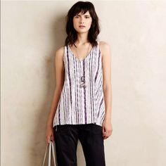 Puella swing top by ANTHRO Adorable hi-lo, tunic length tank top by Puebla. Red, white and blue stripe. Slight flare at the bottom. Brand new with tags. Polyester/rayon/spandex. Anthropologie Tops Tank Tops