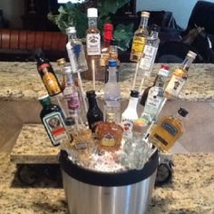 Booze Bouquet... Perfect alcohol bouquet for guys! Easy to make: mini liquor bottles, candy sticks, styrofoam block, and an ice bucket base.