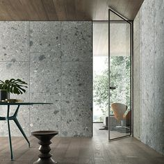 Vela door with magnetic closing profile, brown aluminium frame and riflettente chiaro glass.