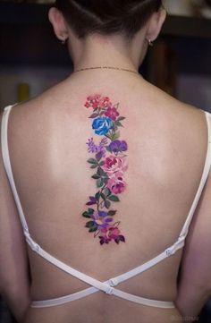 Bright flower tattoo along the spine. #backtattoo #flowertattoo #spine #rosetattoo