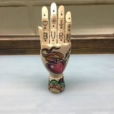 wooden hand mannequin with a neotraditional sacred heart tattoo style drawing with a color mandala design knuckle tattoos.eye anchor and rose https://www.etsy.com/listing/493655013/sacret-heart-wooden-hand-mannequinlove?ref=shop_home_active_10