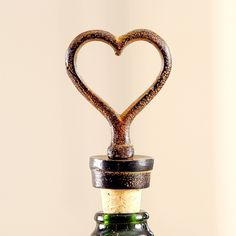 A perfect way to add that extra touch to any dinner party with this heart bottle stopper, finished in Antique brown with a decorative heart design, complete with cork bottom. Made from cast iron, this weighty yet practical item would make any Valentines Day dinner special.