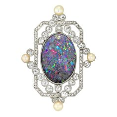 AN OPAL AND DIAMOND BROOCH - Antique & Period Jewellery, Brooches at Bentley & Skinner jewellery shop in London. - An opal and diamond brooch, the oval cabochon-cut black opal, measuring approximately x - Bijoux Art Deco, Art Deco Jewelry, Fine Jewelry, Jewelry Design, Black Opal Jewelry, Selling Jewelry, Jewelry Shop, Antique Jewelry, Vintage Jewelry