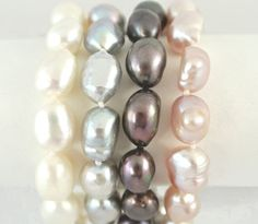 These gorgeous, chunky, magnificent baroque potato pearls are waiting for you! Each 7½ inch single strand bracelet is on double knotted silk cord and closes with a convenient silver-toned magnetic clasp. Available in your choice of cream, silver, midnight or (our favorite) pink, there's one to go with every outfit.