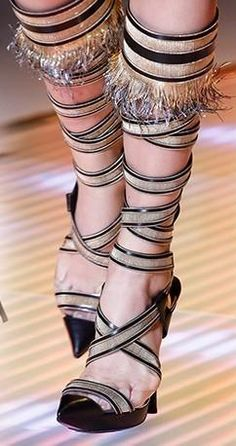 Selena Gomez wearing Versace Fringe Stiletto Sandals.