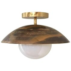 For Sale on 1stDibs - The Sasco is a versatile custom-made solid brass and glass globe light fixture, which can be mounted on the ceiling or wall. Shown here in our factory Ceiling Mounted Light, Brass Ceiling Light, Semi Flush Ceiling Lights, Metal Ceiling, Flush Mount Chandelier, Metal Chandelier, Globe Light Fixture, Light Fixtures, Semi Flush Lighting
