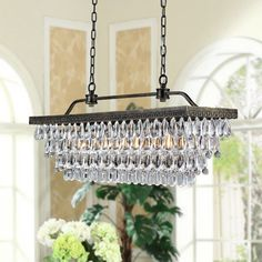Illuminate your entryway, living room or any other room in your home with this elegant rectangular chandelier with crystal bead accents and antique copper finish. The cascade of crystal beads makes this the perfect touch to a formal decor.