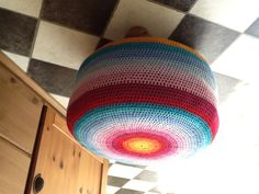 Multicoloured crochet footstool