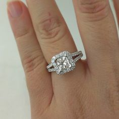 Idea: Halo Engagement Ring. Yes with diamonds around the band.