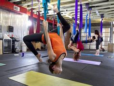 Rebecca Otis works out during a recent Austin Aerial Yoga class taught by Lydia Michelson-Maverick at Dane's Body Shop. Hammocks suspended from the ceiling allow practitioners to perform yoga poses in the air. Photo by Rodolfo Gonzalez, American-Statesman.