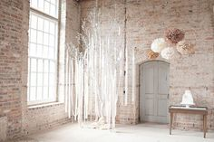 How beautiful do these pom poms and chandeliers look.