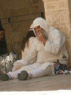 "A man enjoying Matzohs outside the Tomb of King David. Pesach תשע""ה"