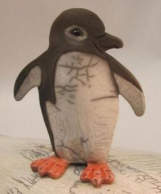 This listing is for ONE happy little raku penguin, ♦♦♦YOU WILL NOT RECEIVE THE ONE PICTURED♦♦♦ but it will be similar. You can choose the style you like.