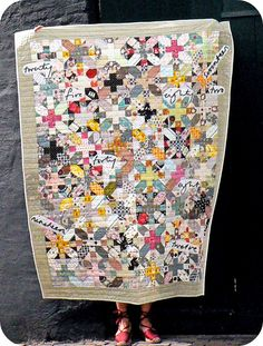 X+O quilt by Leila of Where Orchids Grow. I like the subdued palette (she seems to have appliqued the number-words on top.)