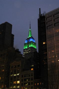 Green and Blue Empire State Building at night, NYC