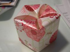 I like buying commercial mini gift boxes, dissemble them and use as templates to make boxes with my own patterned paper. Can also enlarge or reduce the size to suit what's within. Yay another excu...