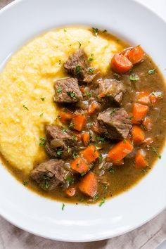 Beef Stew with Cheesy Polenta. So delicious and the perfect comfort food dish. The parmesan polenta is so cheesy and creamy, and the beef stew with carrots is so tasty. Perfect for those cold days, but delicious any time of the year! Fall Recipes, Beef Recipes, Dinner Recipes, Cooking Recipes, Healthy Recipes, Cooking Beef, Italian Cooking, Vegetarian Cooking, Easy Cooking