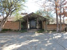 "A mid-century Arthur Elrod-style ""Palm Springs"" home on a gorgeous mature golf course in Oklahoma City - waiting to be torn down!  Noooo!!!!"
