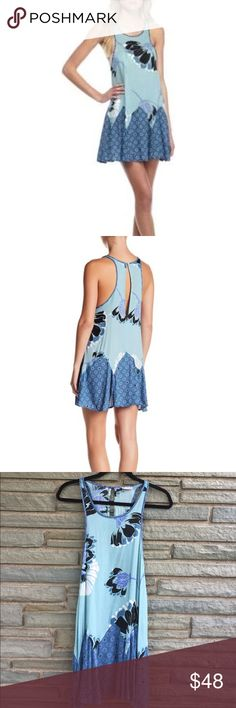 Free People Someone Like You Trapeze Slip NWT. Free People Someone Like You Trapeze Slip in Blue. Features a Keyhole Opening in Back with Button Enclosure. 100% Rayon. Size S Free People Dresses
